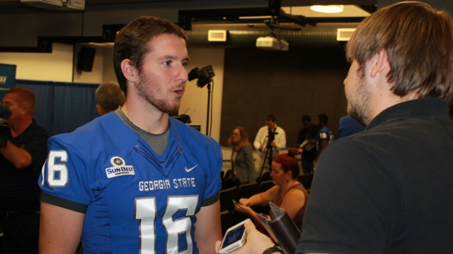 Ben McLane talks to a member of the media during GSU Football's annual media day.