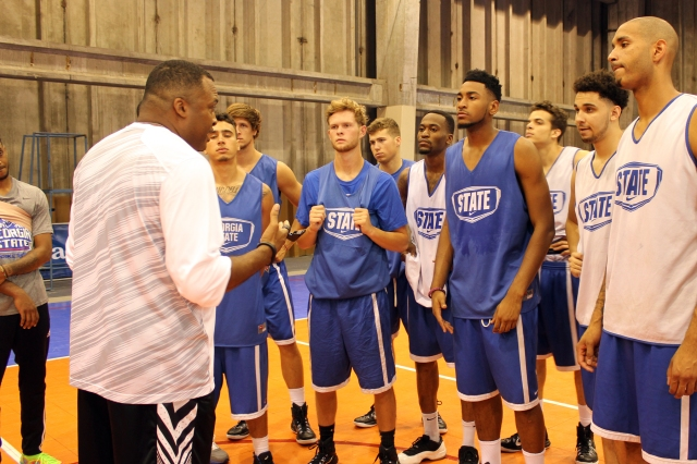 Coach Hunter talks to the team following practice.